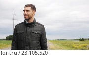Купить «young man in jacket walking along countryside road 15», видеоролик № 23105520, снято 15 июня 2016 г. (c) Syda Productions / Фотобанк Лори