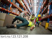 Купить «Workers taking care about their colleague lying on the floor», фото № 23121208, снято 23 марта 2016 г. (c) Wavebreak Media / Фотобанк Лори