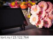 Купить «Digital tablet with pink sunflower», фото № 23122764, снято 17 апреля 2016 г. (c) Wavebreak Media / Фотобанк Лори