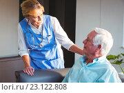 Купить «Nurse taking care of a senior man», фото № 23122808, снято 22 марта 2016 г. (c) Wavebreak Media / Фотобанк Лори
