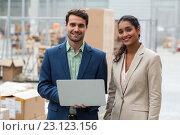 Купить «Portrait of happy managers are posing and smiling with a laptop», фото № 23123156, снято 23 марта 2016 г. (c) Wavebreak Media / Фотобанк Лори