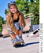 Купить «Teen girl rides his skateboard», фото № 23129568, снято 27 августа 2015 г. (c) Gennadiy Poznyakov / Фотобанк Лори