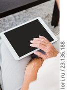 Cropped image of woman using digital tablet. Стоковое фото, агентство Wavebreak Media / Фотобанк Лори