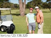 Купить «Portrait of smart golfer couple with arm around», фото № 23138320, снято 14 апреля 2016 г. (c) Wavebreak Media / Фотобанк Лори
