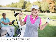 Купить «Happy mature woman carrying golf club while standing by man», фото № 23139320, снято 14 апреля 2016 г. (c) Wavebreak Media / Фотобанк Лори