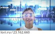 Купить «Smiling woman is using futuristic glasses», видеоролик № 23162660, снято 18 октября 2018 г. (c) Wavebreak Media / Фотобанк Лори