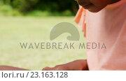 Купить «Close up of little girl using a tablet computer», видеоролик № 23163128, снято 15 октября 2019 г. (c) Wavebreak Media / Фотобанк Лори