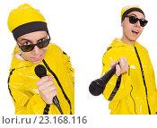 Купить «Funny performer with mic isolated on the white», фото № 23168116, снято 12 декабря 2013 г. (c) Elnur / Фотобанк Лори