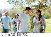 Купить «group of volunteers with trees and rake in park», фото № 23186732, снято 7 мая 2016 г. (c) Syda Productions / Фотобанк Лори