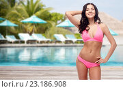 happy young woman in pink bikini swimsuit on beach. Стоковое фото, фотограф Syda Productions / Фотобанк Лори