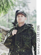 Купить «young soldier or hunter with gun in forest», фото № 23187096, снято 14 августа 2014 г. (c) Syda Productions / Фотобанк Лори