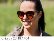 Купить «face of happy young woman in sunglasses outdoors», фото № 23187404, снято 27 мая 2016 г. (c) Syda Productions / Фотобанк Лори