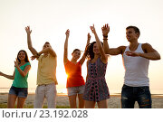 Купить «smiling friends dancing on summer beach», фото № 23192028, снято 3 августа 2014 г. (c) Syda Productions / Фотобанк Лори
