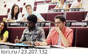 Купить «group of students with notebooks in lecture hall», видеоролик № 23207132, снято 23 июня 2016 г. (c) Syda Productions / Фотобанк Лори