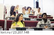 Купить «group of students with notebooks in lecture hall», видеоролик № 23207148, снято 23 июня 2016 г. (c) Syda Productions / Фотобанк Лори