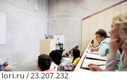 Купить «group of students and teacher in lecture hall», видеоролик № 23207232, снято 24 июня 2016 г. (c) Syda Productions / Фотобанк Лори