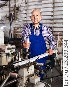 Labour working on lathe machine. Стоковое фото, фотограф Яков Филимонов / Фотобанк Лори
