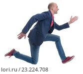 Купить «Бегущий мужчина на белом фоне», фото № 23224708, снято 2 июля 2016 г. (c) Александр Лычагин / Фотобанк Лори