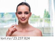 Купить «Beautiful woman preparing for botox injection», фото № 23237824, снято 16 июня 2016 г. (c) Elnur / Фотобанк Лори