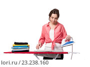Купить «Young woman doing ironing isolated on white», фото № 23238160, снято 13 мая 2016 г. (c) Elnur / Фотобанк Лори