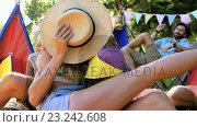 Купить «Hipster couple kissing behind a hat», видеоролик № 23242608, снято 14 декабря 2018 г. (c) Wavebreak Media / Фотобанк Лори
