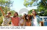 Купить «Portrait of happy hipster friends standing with arm around», видеоролик № 23242752, снято 5 июня 2020 г. (c) Wavebreak Media / Фотобанк Лори