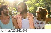 Купить «Smiling hipster friends standing in front of the van », видеоролик № 23242808, снято 14 декабря 2018 г. (c) Wavebreak Media / Фотобанк Лори