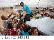 Купить «ice distribution to Iraqi displaced people in Anwald refugee camp, Northern Iraq.», фото № 23243812, снято 10 мая 2016 г. (c) age Fotostock / Фотобанк Лори