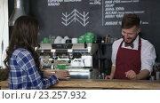 Купить «Waiter and beautiful girl at a cafe», видеоролик № 23257932, снято 13 июля 2016 г. (c) Raev Denis / Фотобанк Лори