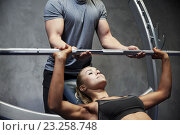 Купить «man and woman with barbell flexing muscles in gym», фото № 23258748, снято 19 апреля 2015 г. (c) Syda Productions / Фотобанк Лори