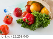 Купить «basket of fresh vegetables and water at kitchen», фото № 23259040, снято 3 июня 2016 г. (c) Syda Productions / Фотобанк Лори