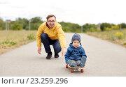Купить «happy father and little son riding on skateboard», фото № 23259296, снято 5 июня 2016 г. (c) Syda Productions / Фотобанк Лори