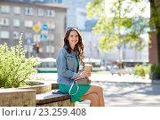 Купить «happy young woman drinking coffee on city street», фото № 23259408, снято 12 мая 2016 г. (c) Syda Productions / Фотобанк Лори