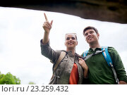 smiling couple with backpacks hiking, фото № 23259432, снято 27 мая 2016 г. (c) Syda Productions / Фотобанк Лори