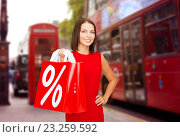 Купить «woman with shopping bags over london city street», фото № 23259592, снято 15 августа 2013 г. (c) Syda Productions / Фотобанк Лори