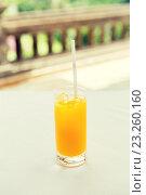 Купить «glass of fresh orange fruit juice at restaurant», фото № 23260160, снято 21 февраля 2015 г. (c) Syda Productions / Фотобанк Лори