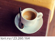 Купить «cup of black coffee with spoon and saucer on table», фото № 23260164, снято 13 февраля 2015 г. (c) Syda Productions / Фотобанк Лори
