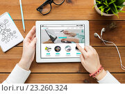 Купить «close up of woman with tablet pc on wooden table», фото № 23260324, снято 22 марта 2016 г. (c) Syda Productions / Фотобанк Лори