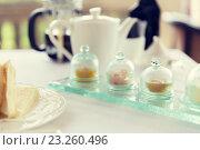 Купить «close up of tea time set with jam on table», фото № 23260496, снято 21 февраля 2015 г. (c) Syda Productions / Фотобанк Лори