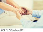 close up of senior and young woman hands. Стоковое фото, фотограф Syda Productions / Фотобанк Лори