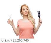 Купить «young woman with scissors and hairbrush», фото № 23260740, снято 30 апреля 2016 г. (c) Syda Productions / Фотобанк Лори