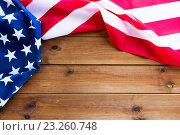 Купить «close up of american flag on wooden boards», фото № 23260748, снято 6 мая 2016 г. (c) Syda Productions / Фотобанк Лори
