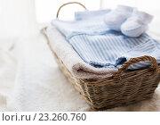 Купить «close up of baby clothes for newborn boy in basket», фото № 23260760, снято 25 мая 2016 г. (c) Syda Productions / Фотобанк Лори