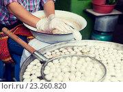 Купить «close up of cook frying meatballs at street market», фото № 23260820, снято 7 февраля 2015 г. (c) Syda Productions / Фотобанк Лори