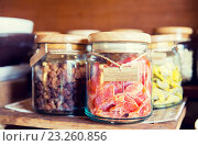Купить «close up of jars with dried fruits at grocery», фото № 23260856, снято 15 февраля 2015 г. (c) Syda Productions / Фотобанк Лори