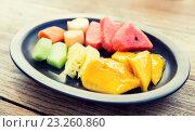 Купить «plate of fresh juicy fruits at asian restaurant», фото № 23260860, снято 14 февраля 2015 г. (c) Syda Productions / Фотобанк Лори