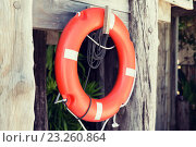 Купить «lifebuoy or life preserver hanging on rescue booth», фото № 23260864, снято 15 февраля 2015 г. (c) Syda Productions / Фотобанк Лори