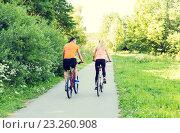 Купить «happy couple riding bicycle outdoors», фото № 23260908, снято 5 июля 2015 г. (c) Syda Productions / Фотобанк Лори