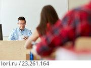 Купить «students and teacher with tablet pc at school», фото № 23261164, снято 3 июня 2020 г. (c) Syda Productions / Фотобанк Лори