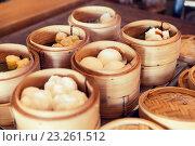 Купить «meat or rice balls in wooden containers», фото № 23261512, снято 15 февраля 2015 г. (c) Syda Productions / Фотобанк Лори